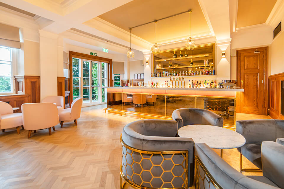 Guests can relax in the luxurious bar area at Pelham House in Sussex
